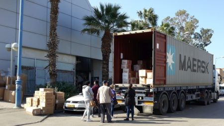 Aid container being unloaded in Haifa, Israel