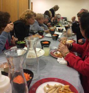Elderly Israelis enjoy a hot meal