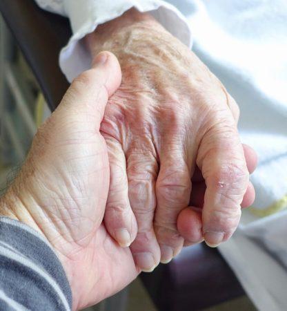 Holding hand of Holocaust Survivor