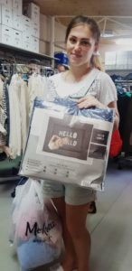 Single mother in Israel holding donated play mat from Israel Relief Aid
