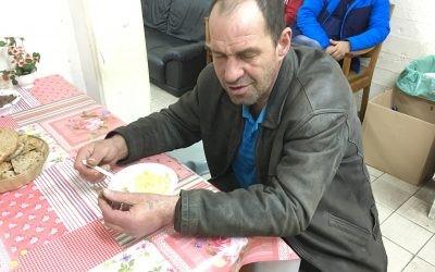 Roman, homeless man, eating soup in Tel Aviv homeless center