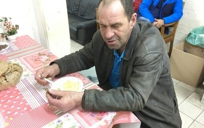 Roman, homeless man, eating soup in Tel Aviv homeless center