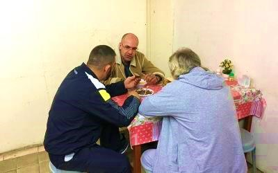two homeless people being given food at Tel Aviv Homeless center