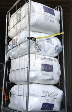 Unloading shipment of new blankets from Israel Relief Aid container