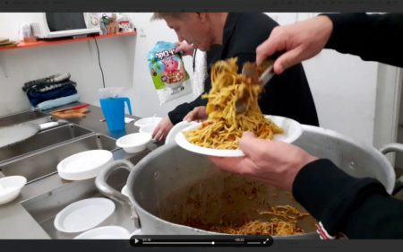 Volunteers cooking at the Tel Aviv Homeless Center
