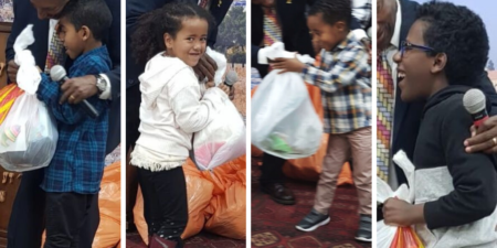 Ethiopian Israeli children receiving gifts for Hanukkah