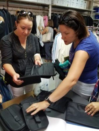Women selecting items at Israel Relief Aid center partner in Galilee