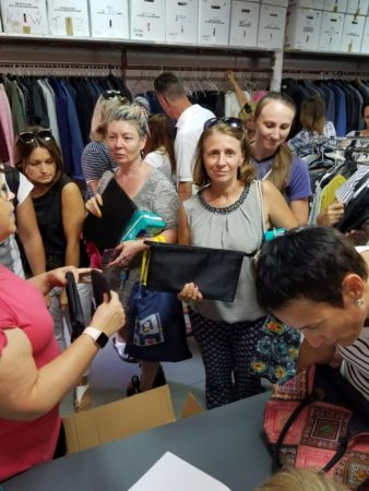 Women picking out items at Israel Relief Aid Center partner in Galilee
