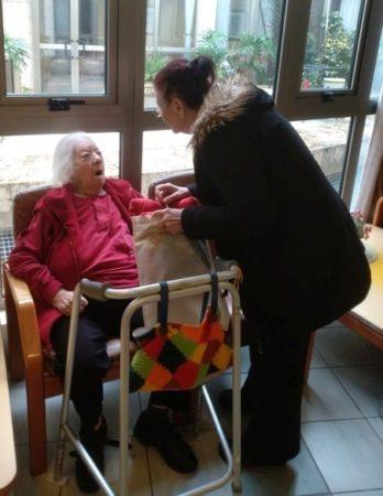 Holocaust Survivor receiving winter supplies