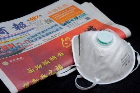 Coronavirus mask and asian newspaper