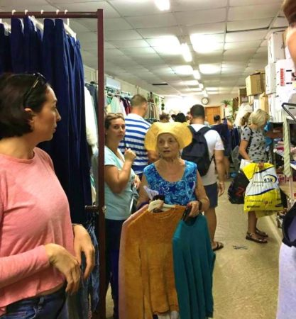 People browsing for clothing at Carmiel Aid Center