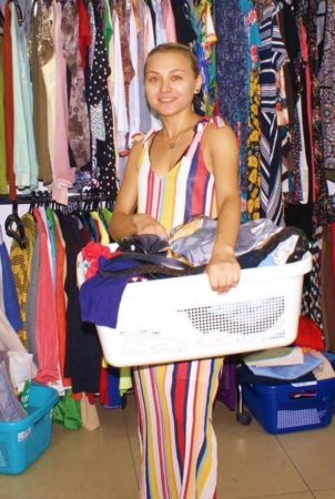 Israeli woman receiving clothing at Jerusalem aid center