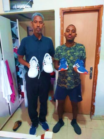 Ethiopian Israelis receiving sneakers from israel Relief Aid