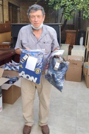 Man receives Israel Relief Aid in Ramle