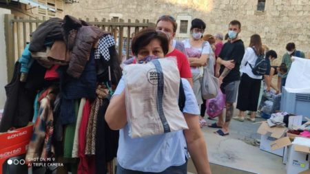 Woman receives Israel Relief Aid in Ramle
