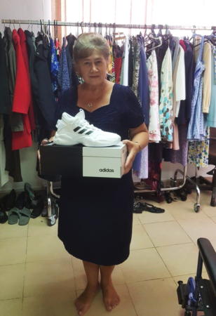Holocaust Survivor receives new shoes from Israel Relief Aid center partner