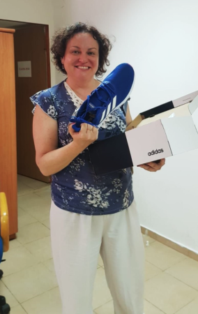 Ukrainian immigrant receives new shoes from Israel Relief Aid center partner