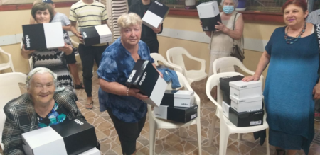Holocaust Survivors in Beer Sheva receiving sneaker gift from Israel Relief Aid