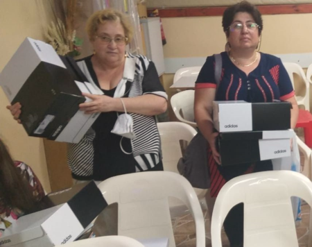 Elderly in Beer Sheva receiving sneaker gift from Israel Relief Aid