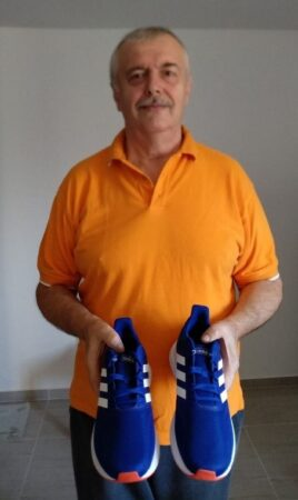 Immigrant receives new pair of sneakers donated from Israel Relief Aid