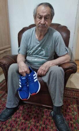Senior receives new pair of sneakers donated from Israel Relief Aid