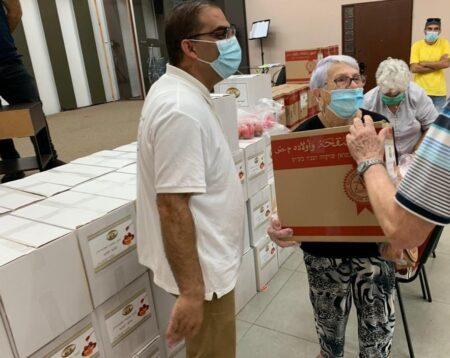 Elderly Israeli woman receives Israel Relief Aid Rosh Ha Shanah food gift