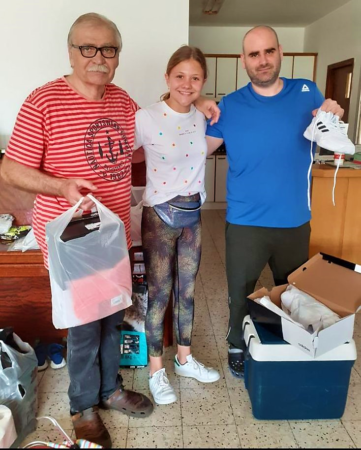Immigrant family receiving new shoes from Israel Relief Aid