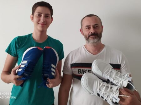 Man and son receiving shoe donation from Israel Relief Aid