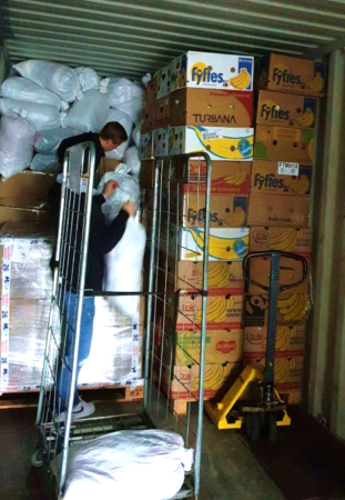 Workers loading aid into container