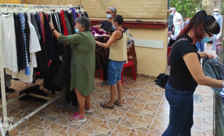Israeli women browse clothing at Beer Sheva aid center