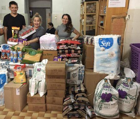 Tel Aviv Aid Center Volunteers receive Israel Relief Aid food supplies donation