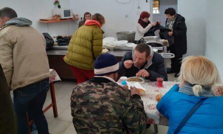 Homeless receiving meal in Tel Aviv Homeless Center