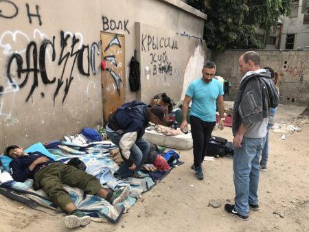 Homeless resting outside of Tel Aviv Homeless Cafe