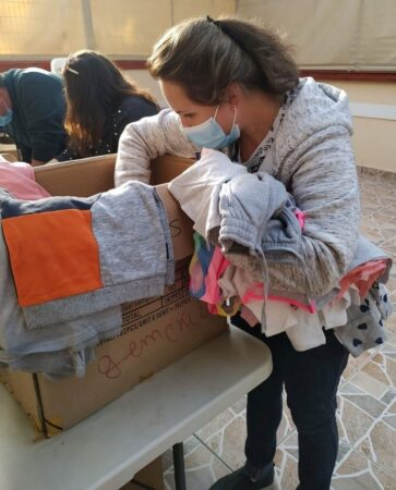 Israeli woman picking out clothing at Beer Sheva Aid Center