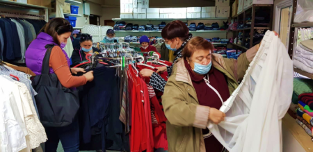 Israeli immigrants browsing through clothing and home goods in Israel Relief Aid Center Partners