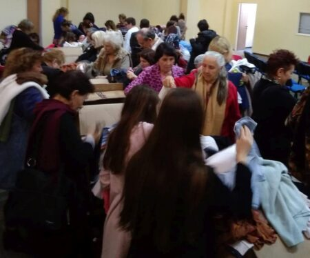 Israelis in need looking through donated clothing from Israel Relief Aid
