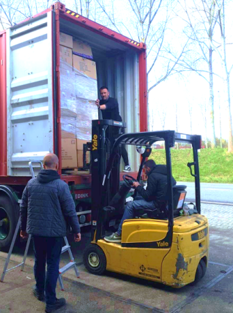 Crew loading an Israel Relief Aid container in the Netherlands