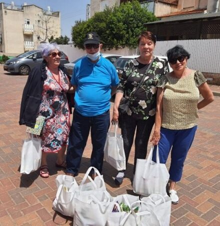 Holocaust Survivors in Israel receiving grocery bags from Israel Relief Aid for Yom HaShoah