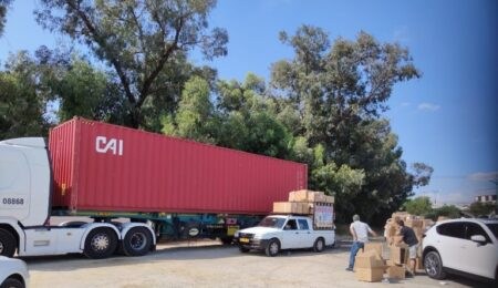 Aid center managers picking up aid from our Israel Relief Aid container